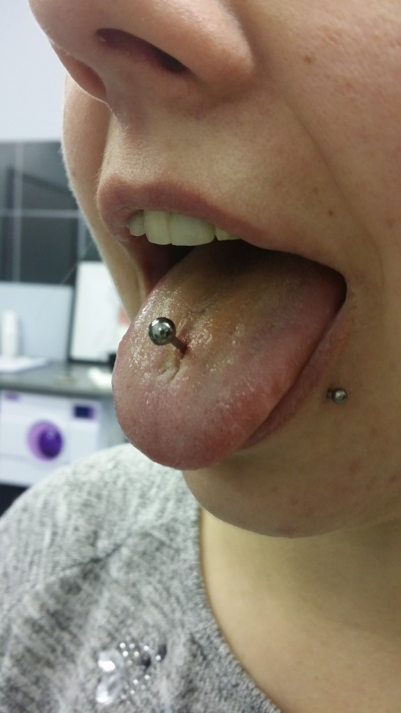tongue pircing by dark rose tattoo