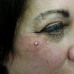 dermal anchor piercing by Dark Rose Tattoo