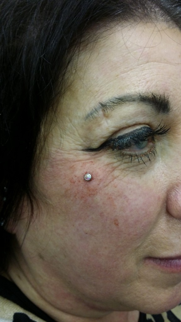 dermal anchor piercing by Dark Rose Tattoo