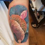 Lotus flower bud tattoo by #JustynaKurzelowska @darkrosetattoo  Used to create this: @radiantinklab @eternalink @cheyenne_tattooequipment  @dermalizepro
